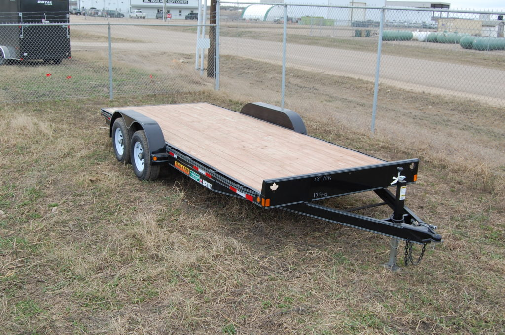 Double A Tandem ATV Trailer 8.5'w x 24'L. c/w (2) 3500 lbs axles, Aluminum slush gaurd, Plywood decking and 4.5' x 7' slide in ramp.