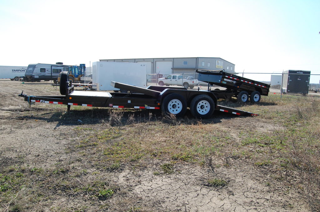 Double A (trail pro) 16' deck over trailer. c/w (2)7000lbs axles,rub rails,LED lighting,7' slide in ramps.