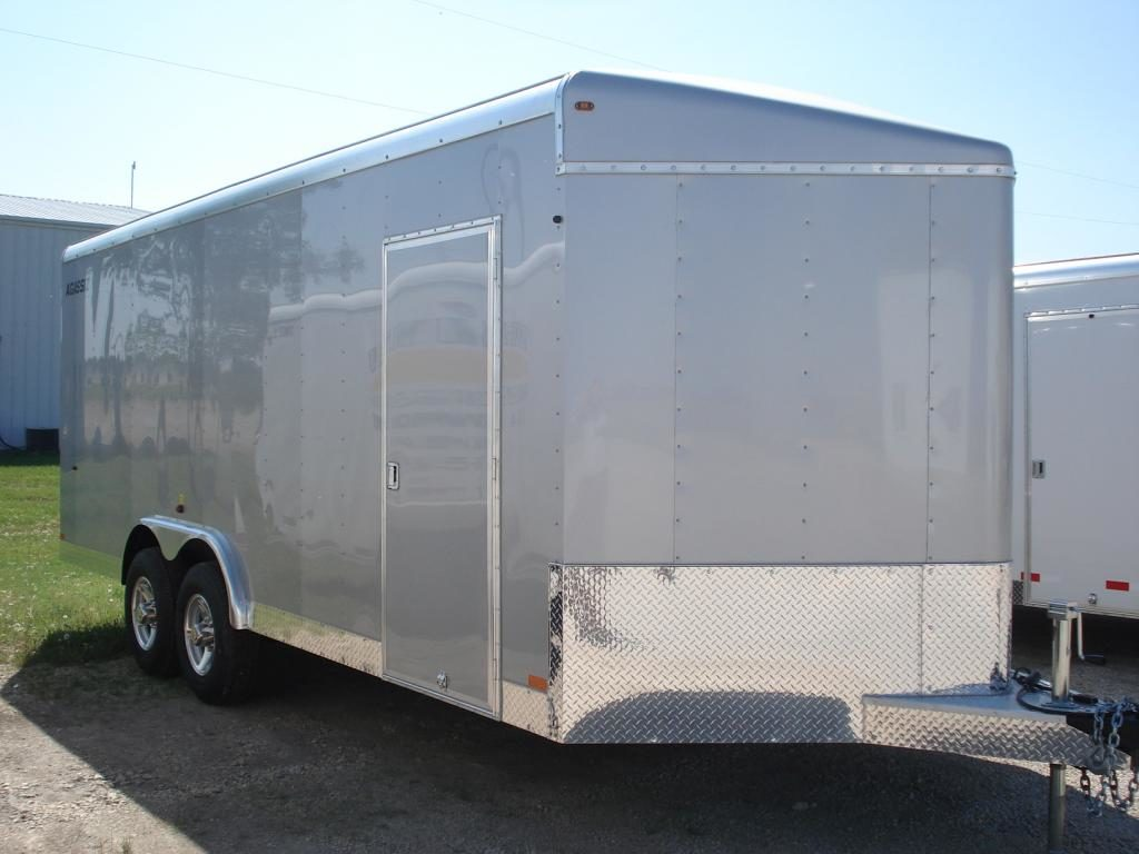 agassiz 8'w x 20'L v-nose tandem axle enclosed trailer. c/w 2 7000lbs axles, aluminum rims, 8 in floor d-rings and lamanated (screwless) exterior walls.