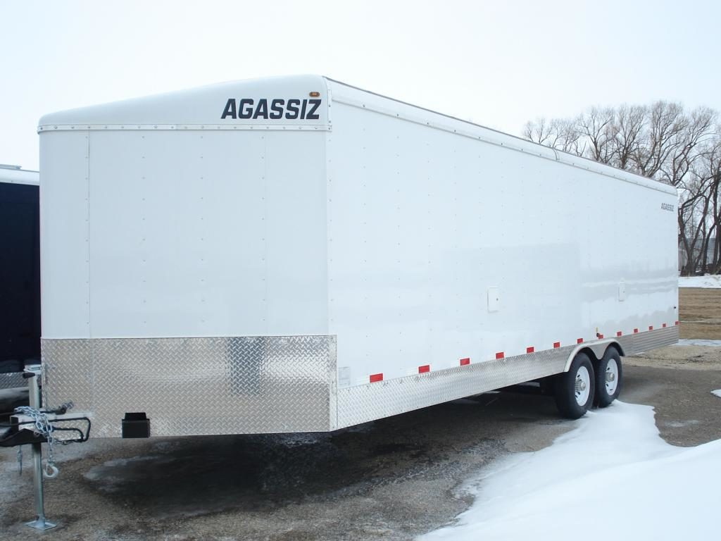 agassiz 8.5'w x 24'L v-nose (sno sport) enclosed trailer.c/w 2 500lbs axles,aluminum rims,quad flooring, 2 sideways vents,2 side fuel doors,2 dome lights, quad flooring and lamanated (screwless) exterior walls.